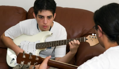Guitar student learning chords