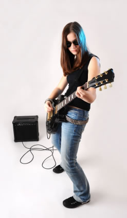 Rocker girl with her guitar and amp