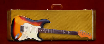 Well used Fender Strat and case